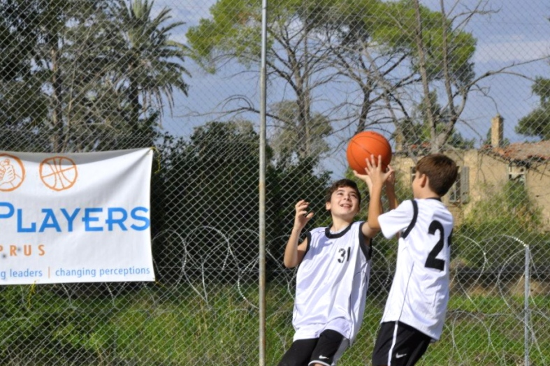 Two Children Participating in a Basketball Drill During a PPI Twinning in the UN Buffer Zone