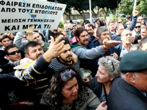 Angry demonstrators protest as lawmakers discuss new austerity laws in Cyprus' parliament, December 12, 2012 (Reuters / Andreas Manolis)