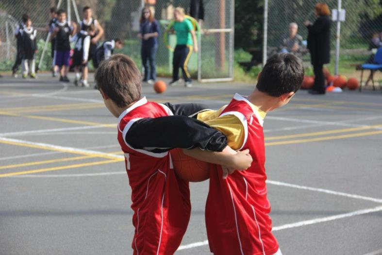 Teaching values such as teamwork and trust through basketball drills