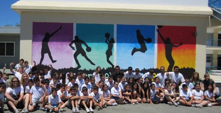 A PeacePlayers Mural announces our presence on the walls of the elementary school in Kolossi