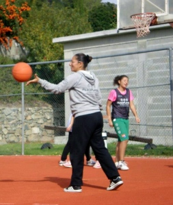 Coach Zalihe on the court with PeacePlayers