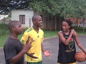Some of the PPI-SA family (Thobani, Sifiso, and Andile) playing basketball before work!