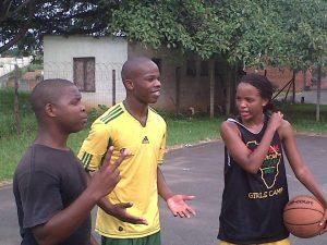 Some of the PPI-SA family (Thobani, Sifiso, and Andile) playing basketball before work!