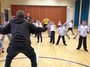 """PPI-NI participants and staff play a game of """"MJ Says"""" at a recent twinning."""