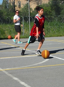 Nesli, one of our Lapta girls, dribbles the ball up the court during the twinning