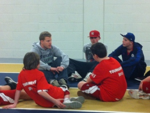"""International Fellow leads a conversation with tournament participants during an educational """"timeout."""""""