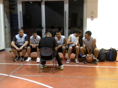 LDP team watching intently as the coach draws up a play