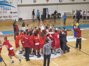 The boys and girls teams from Turkey celebrate center court after their World Championship victories