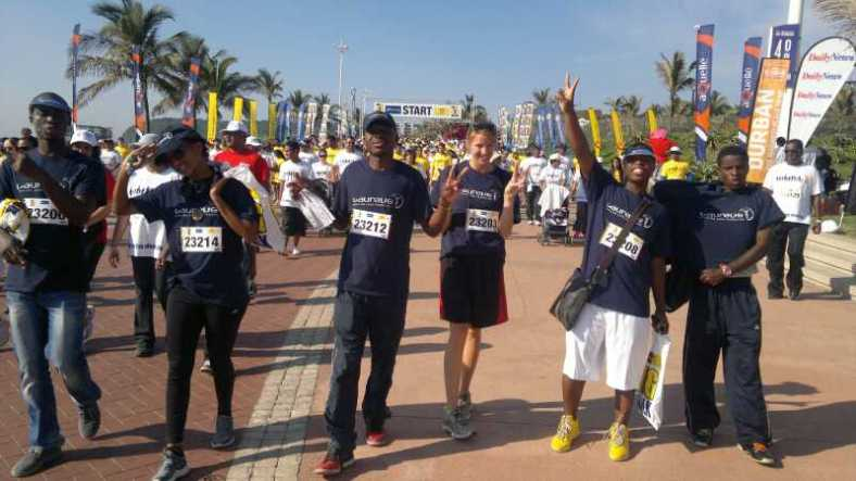 PPI staff members set out from the starting line. From L to R: Eddy Bishogo (coach), Andile Msomi (coach), Sifiso Mchunu (coach), Kristin Degou (fellow), Thobani Khumalo (office staff), and Musawenkosi Manda (coach).