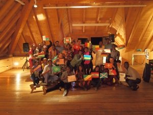 Each participant holding the flag of their home country during the Soiree Culturelle on the last evening of the camp