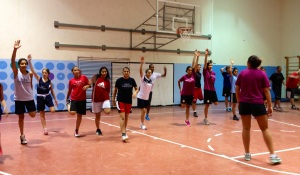 The Canadian Women's team leading a warm up for PPI-ME participants