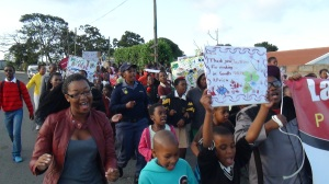 Many children wrote messages to Mandela on signs and carried them through the streets.