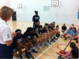 The Yale Woman's team have a 'question and answer' time with the younger girls.