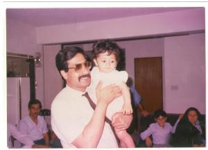 My father and I in our old apartment celebrating eid with our aunts, uncles, and cousins.