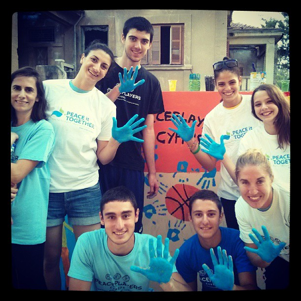 PeacePlayers staff and young leaders put a hand in for peace