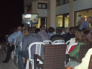 Crowds from both communities gathered inside and outside at The Home for Cooperation to follow the discussion on the upcoming negotiations