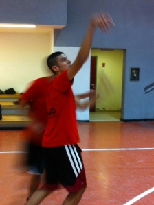 Hamoudi shooting a three-pointer during Blu's shooting competition