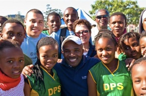 Baby Jake poses with PPI-SA players, staff, and others at 16th CityWide Tournament in June 2010.