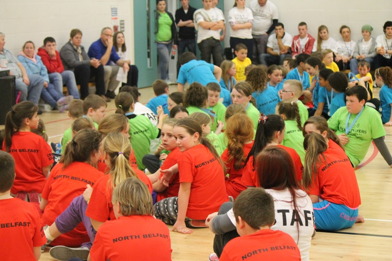 The teams from each side of the city gather together as one PeacePlayers International - Northern Ireland team to watch the awards ceremony.