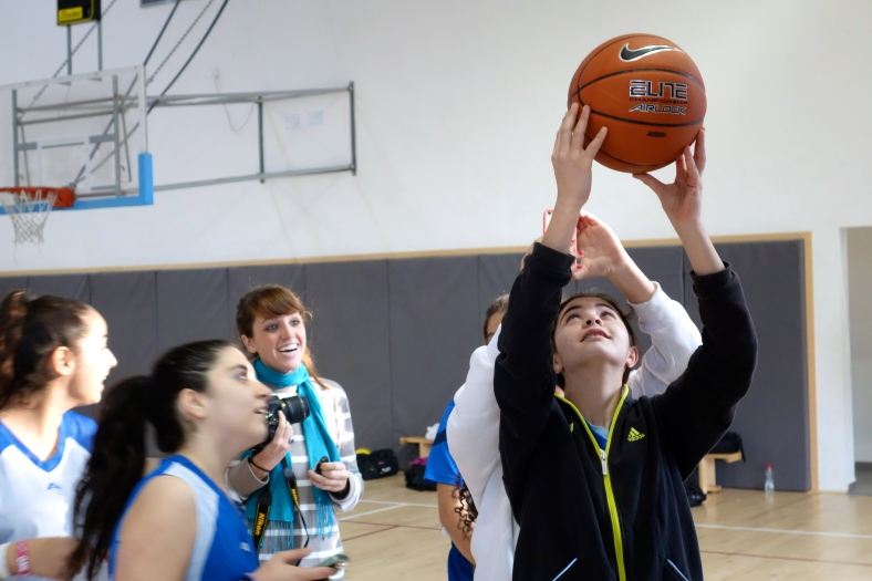 Samantha Dols enjoys watching kids from Holon and Ussafiya find interesting vantage points on the basketball court.
