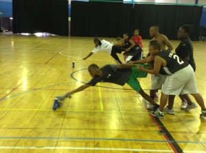 Coaches learn one of our life skills activities during a basketball session at Umlazi Indoor Sportcentre.
