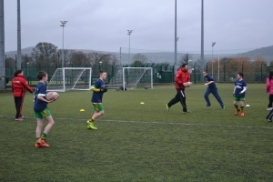 Football Coach Johnny O'Neill takes the kids for a dribbling session to top up on their skills