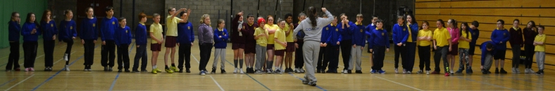 Coach Megan teaches St. Luke's and Belvoir Park Primary Schools about the lines on the basketball court!