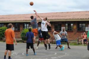 Tim (orange shorts) led his MBA classmates against PPI staff in a friendly game in Umlazi.