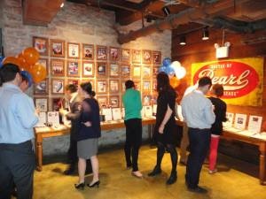 Guests bidding on various items at the silent auction