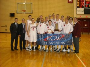 Bryan (holding trophy) with his team after winning the 2011 ECAC Metro Tournament
