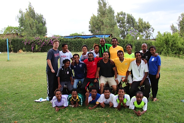 The coaches pose for a picture after a day of training