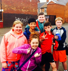 West Belfast participants, wait in their basketball gear after school to get picked up by the bus. Smiles all round!