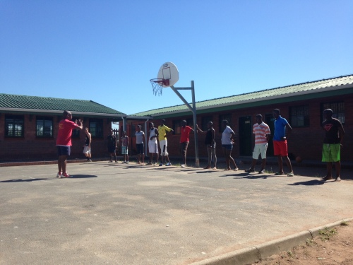 Eager players from various local high schools await instruction during the year's inaugural LDP practice in Umlazi.