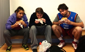 Heni, Jamie, and Jack from left to right eating shawarma before coaching in Jerusalem