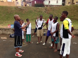 PPI-SA's Ntobeko Ngcamu coaches up some LDP players at halftime of their game.