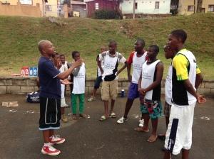 PPI-SA's Ntobeko Ngcamu coaches up some LDP players at halftime of their game.