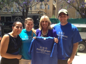 PPI-CY presents Dr. Jill Biden with a PeacePlayers shirt on a visit to our office