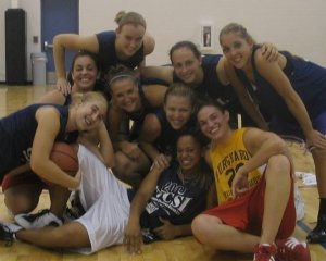 PPI-CY fellow Ashley Johnson (far left with the ball) and her college teammates on the court