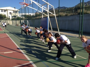 Players in Cyprus taking part in a basketball drill.