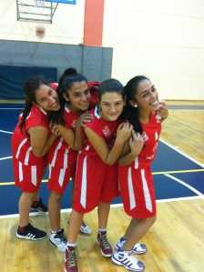 Hadas and three of her fellow PeacePlayer participants celebrating after a big win