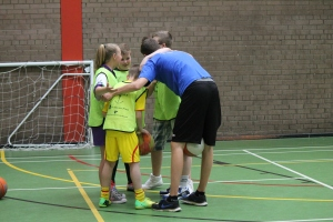 Participants from different PPI-NI twinning programmes come together with Coach Joe at PPI-NI's summer basketball camp.