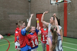 Children from different communities come together to play basketball with PeacePlayers International - Northern Ireland.