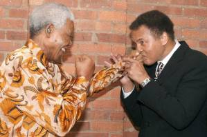 Mandela, an avid boxer in his younger days, plays around with Muhammad Ali.