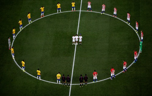 Brazil and Croatia gather  before the first game of The 2014 World Cup, in  a scene that's eerily similar to the the PPI Pledge performed before all PPI games in S. Africa
