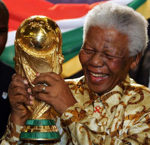Nelson Mandela with World Cup trophy after South Africa won the bid to host the 2010 tournament.