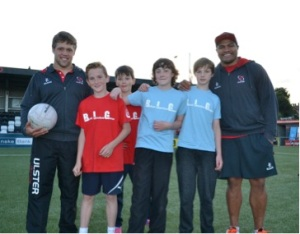 Ulster Rugby stars Nick Williams and Jonny Murphy taking pictures and signing autographs with PeacePlayers participants