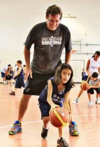 Spurs GM, RC Buford coaches a young PeacePlayer.