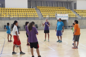 Evan leading the girls team through a series of basketball drills