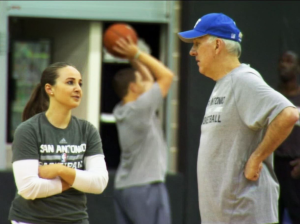 Hammon talks basketball with Coach Papovich