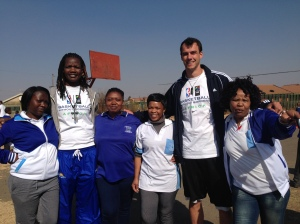 Fellow Ben Constable poses along with some Basketball Without Borders team members and supporters.